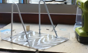 diy-a-desk-paper-organizer-from-a-plastic-hanger-and-lucite-boxes